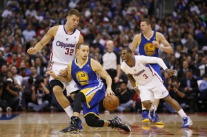 Blake Griffin e Chris Paul contro Steph Curry e Klay Thompson in una gara dell'anno passato