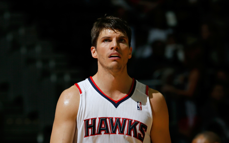 ATLANTA, GA - DECEMBER 06: Kyle Korver #26 of the Atlanta Hawks walks back on the court against the Cleveland Cavaliers after setting an NBA record by making a 3-pointer in his 90th straight game at Philips Arena on December 6, 2013 in Atlanta, Georgia. NOTE TO USER: User expressly acknowledges and agrees that, by downloading and or using this photograph, User is consenting to the terms and conditions of the Getty Images License Agreement. (Photo by Kevin C. Cox/Getty Images)