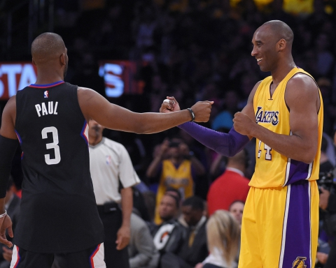 Los Angeles Clippers guard Chris Paul, left, and Los Angeles Lakers forward Kobe Bryant greet each other prior to an NBA basketball game, Wednesday, April 6, 2016, in Los Angeles. (AP Photo/Mark J. Terrill)