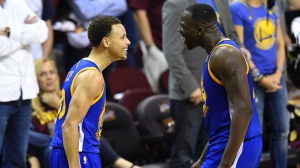 Jun 16, 2015; Cleveland, OH, USA; Golden State Warriors guard Stephen Curry (30) and forward Draymond Green (23) celebrate during the fourth quarter of game six of the NBA Finals against the Cleveland Cavaliers at Quicken Loans Arena. Warriors won 105-97. Mandatory Credit: David Richard-USA TODAY Sports