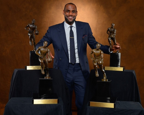 MIAMI, FL - MAY 5: LeBron James #6 of the Miami Heat poses with his collection of Maurice Podoloff Trophies after being named the 2012-2013 Kia NBA Most Valuable Player (MVP) of the Year for the fourth time on May 5, 2013 at American Airlines Arena in Miami, Florida. NOTE TO USER: User expressly acknowledges and agrees that, by downloading and or using this photograph, User is consenting to the terms and conditions of the Getty Images License Agreement. Mandatory Copyright Notice: Copyright 2013 NBAE (Photo by Jesse D. Garrabrant/NBAE via Getty Images)