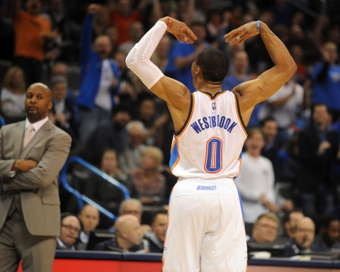 Feb 22, 2015; Oklahoma City, OK, USA; Oklahoma City Thunder guard Russell Westbrook (0) reacts after a play against the Denver Nuggets at Denver Nuggets head coach Brian Shaw looks on during the second quarter at Chesapeake Energy Arena. Mandatory Credit: Mark D. Smith-USA TODAY Sports