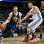 Utah Jazz forward Gordon Hayward, left, drives for a shot past Denver Nuggets forward Danilo Gallinari, center, as Jazz center Rudy Gobert watches during the second half of an NBA basketball game Thursday, Nov. 5, 2015, in Denver. Utah won 96-84. (AP Photo/David Zalubowski)