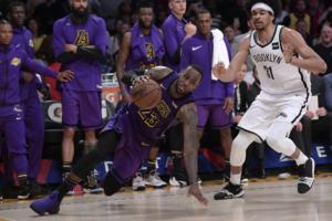 LeBron James and Jarrett Allen, Los Angeles Lakers vs Brooklyn Nets at Staples Center
