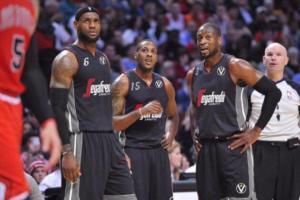 Mario Chalmers tra LeBron James e Dwyane Wade. Il tampering varca i confini della NBA